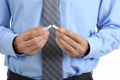 Business man breaks down the cigarette, close up