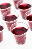 picture of communion-cup  - Many communion cups with wine in them over plain white background - JPG