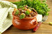 stock photo of stew  - Beef stew with vegetables and herbs in a clay pot  - JPG