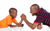 stock photo of wrestling  - Cute african boy wearing a bright orange t - JPG