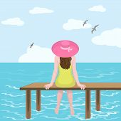 Girl in hat and sea