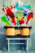 stock photo of bongo  - Photo of bongo drums with wooden background - JPG
