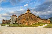 picture of peculiar  - Brasov Citadel in the evening Romania - JPG