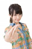 Asian young woman cross finger with cheat sign. Isolated on the white background.