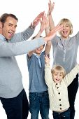 Jubilant Family Celebrating And Partying Indoors