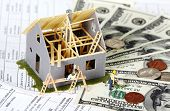 Family house with money. Construction background.