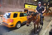 New York City, Usa - Police Officer Rides His Horse