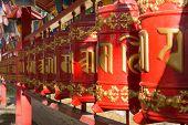 stock photo of sanskrit  - Prayer wheels with mantra Sanskrit text Buddha church Datsan Gunzechoinei Saint Petersburg Russia - JPG