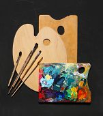 Paint brushes and wooden palette used for painting