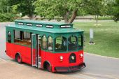 Old Fashioned Trolley In A Park Setting