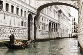 stock photo of foreshortening  - foreshortening of a venetian canal where a gondola with a couple of tourist on board is passing
