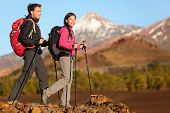 Hikers people hiking - healthy active lifestyle. Hiker people hiking in beautiful mountain nature la