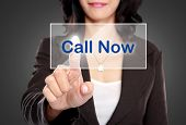 Business Woman Push To  Call Now Button On Virtual Screen