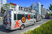 OSAKA, JAPAN - MAY 4, 2014: A caravan of a Uyoku dantai vans drives through Osaka. The right wing gr