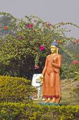 picture of garden sculpture  - Buddha sculpture in garden near templeLumbini Nepal - JPG