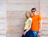 Couple Standing Near The Wall Outdoors
