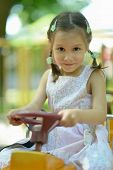 Portrait of little girl on playground