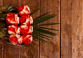 Beautiful Bouquet Of Red Roses On Wooden Background