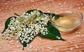 image of elderberry  - Health elderberry flowers drink on a wooden table - JPG
