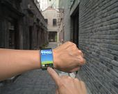 Male Hand Wear Iwatch With Finger Touching Colorful Screen