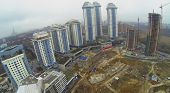 MOSCOW, RUSSIA - NOV 22, 2013: Construction of residential complex Dolina Setun near the apartment complex Vorobyovy Gory, aerial view. Complex located on the right bank of the Moskva River