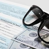 Usa 1040 Tax Form With Glasses And Two 100 Us Dollar Bills