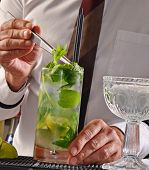 Barman preparing mohito cocktail.Bartender preparing cocktail.