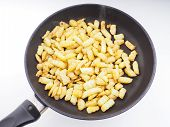 Frying Chopped Potatoes In A Fry Pan