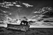 Abandoned Fishing Boat On Beach Black And White Landscape At Sunset