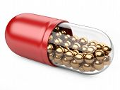 Red Capsule With Vitamins And Minerals.