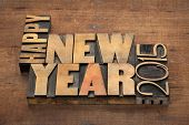 Happy New Year 2015 greetings  - text in vintage letterpress wood type blocks on a grunge wooden bac
