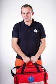 picture of paramedic  - Vertical view of paramedic with first aid kit - JPG
