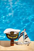 Marine Cap On A Telescope And Ship Next To The Pool