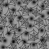 Seamless halloween pattern with spiderweb in halftones.