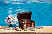 Flowers Textile Stuffed Fish And Treasure Chest Next To The Pool