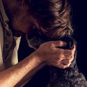Loving Man Hugging His Terrier Dog