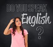 Composite image of pretty brunette thinking against blackboard