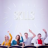 The word skills against college students raising hands in the classroom