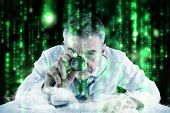 Mature businessman running diagnostics against lines of green blurred letters falling