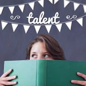 The word talent and bunting against student holding book