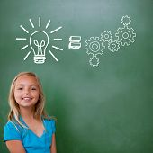 Idea and innovation graphic against cute pupil smiling