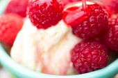Organic Raspberries On Vanilla Icecream
