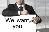 Businessman Pointing On Sign We Want You