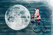 Merry Christmas Around The World - Greeting Card With Text Decorated With Wood, Santa And An Old Uni