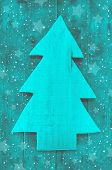Christmas Background In Turquoise Green Color Of A Handmade Carved Tree.