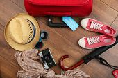 stock photo of theft  - Suitcase and tourist stuff with inscription travel insurance on wooden background - JPG
