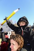 Boy rides dad's shoulders with oversize pencil