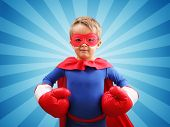 stock photo of strength  - Superhero child with boxing gloves concept for childhood - JPG