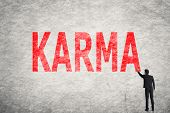 picture of karma  - Asian businessman write text on wall - JPG
