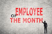 picture of employee month  - Asian businessman write text on wall - JPG